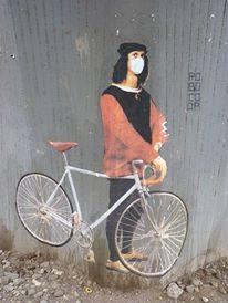 renaissance mann mit fahrrad und maske